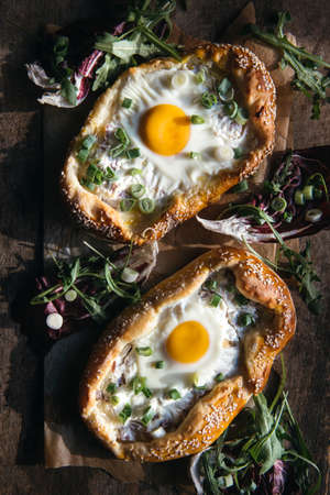 mini pizza: Homemade mini pizza with fried egg and sliced onions