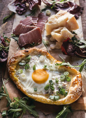 mini pizza: Juicy mini pizza with fried egg,parmesan cheese,ham.Selective focus Stock Photo