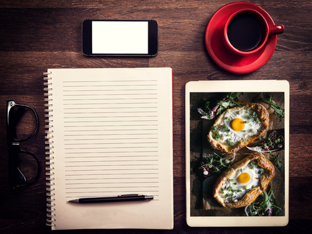 mini pizza: Office and love concept with photos of mini pizza with fried eggs Stock Photo