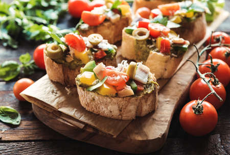 collation: Traditional Italian bruschettas served on wooden board,selective focus