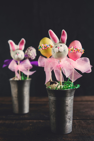 cake pops: Easter concept with cake pops in metal glasses,selective focus Stock Photo