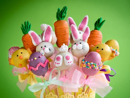 cake pops: Easter basket with cake pops on green background,selective focus
