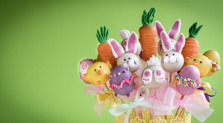 Easter cake pops concept on green background with copy space Stock Photo