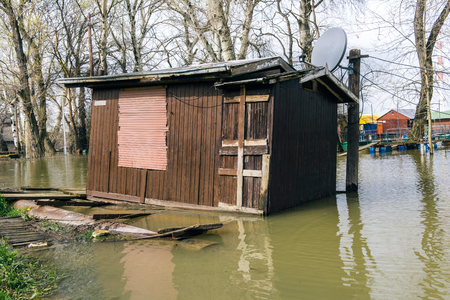house flood: River house boat in flood Stock Photo