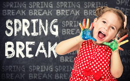 Spring break announcement by happy girl Standard-Bild