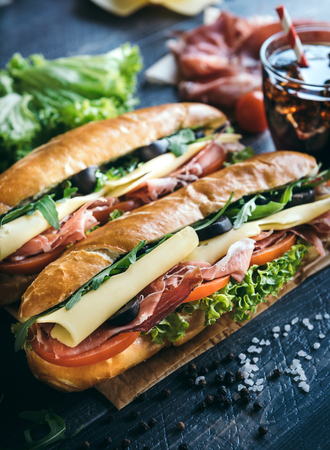 filled roll: Submarine sandwiches served on the table,selective focus Stock Photo