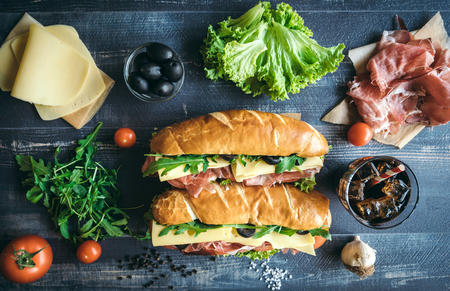filled roll: Submarine sandwiches served on the table from above,selective focus