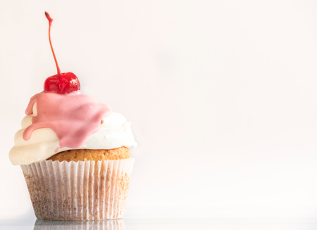 Cherry on the top of sweet homemade cup cake,selective focus and copy space