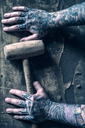 tattoed: Hammer in the tattoed hands