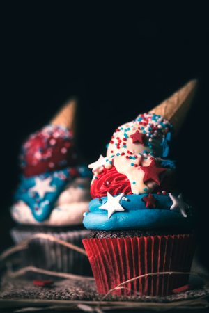 Sweet homemade cup cake with USA flag decoration,independence day concept,selective focus Stock Photo