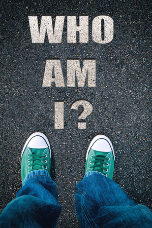 Brand new green shoes from above on asphalt with who I am sign