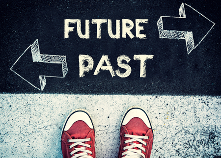 Student standing above the future and past sign,dilemma concept