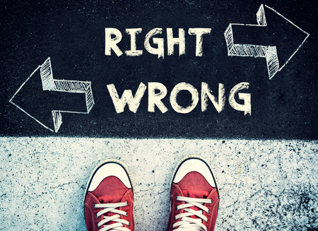 difficult lives: Student standing above the wrong and right sign,dilemma concept Stock Photo