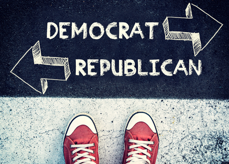 nomination: Student standing above the sign democrat and republican
