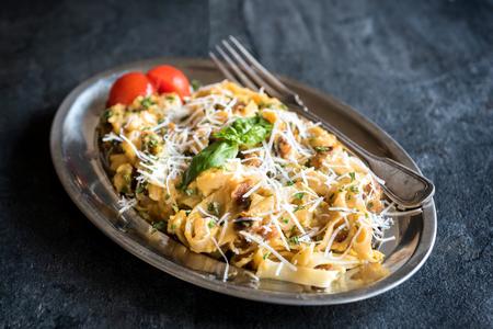 gastro: Traditional Italian pasta carbonara in the metal plate,selective focus