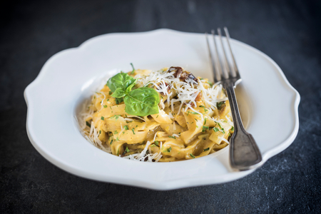 gastro: Served pasta carbonara in the plate,selective focus Stock Photo