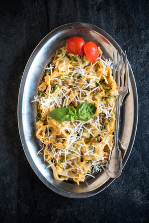 gastro: Served pasta carbonara in the metal plate,selective focus
