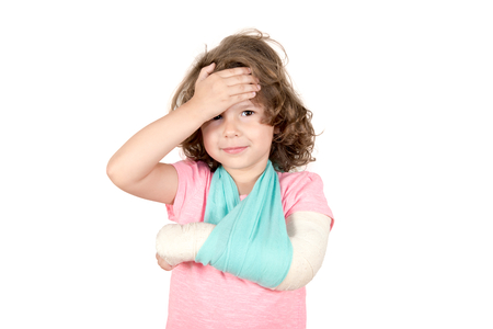 Little child with the broken hand isolated on white background