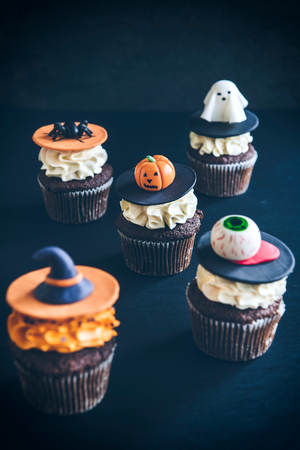 Funny delicious cup cakes for Halloween on the table,selective focus