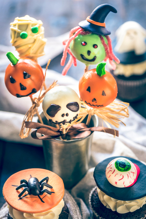 Cake pops and cup cakes decoration for Halloween,selective focus Stock Photo
