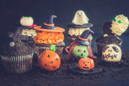 Halloween sweet decoration with cup cakes and cake pops,selective focus Stock Photo