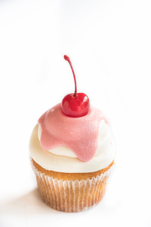 cu: Vanilla cup cake with cherry on white background,selective focus