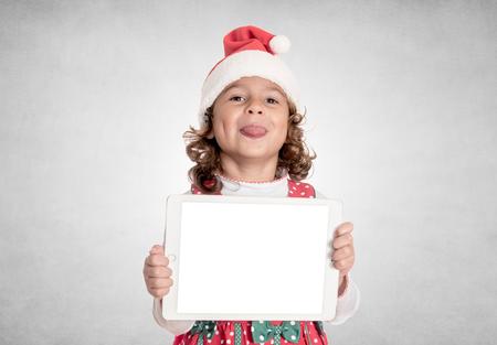 mocking: Little Santa mocking and holding blank screen tablet pc