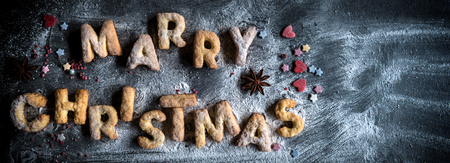 backing: Merry Christmas concept with cookies on dark background with blank space Stock Photo