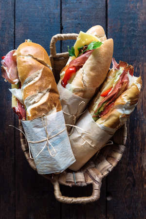 filled roll: Submarine sandwiches served in the basket Stock Photo