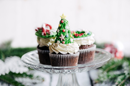 Sweet Christmas cup cakes served,selective focus