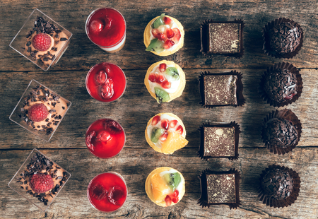 Assorted of fruit and chocolate mini cakes on the table