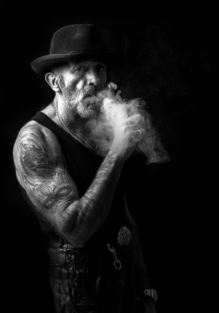 Smoking man portrait in black and white