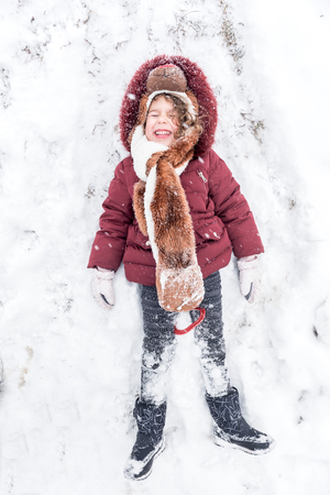 Little child playing in the snow photo