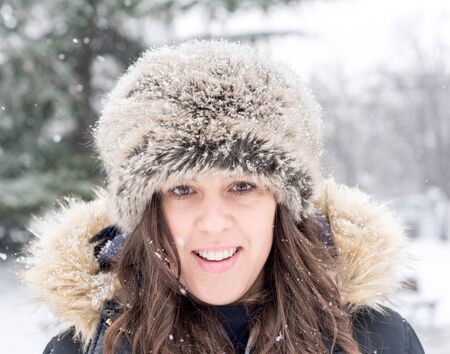 Portrait of positive female during the snow storm photo