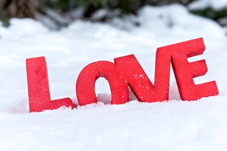 Love sign in the snow,selective focus