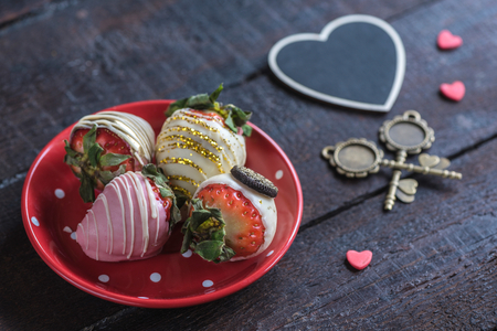 Served chocolate strawberries in the plate,selective focus