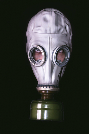 Head with gas mask on dark background