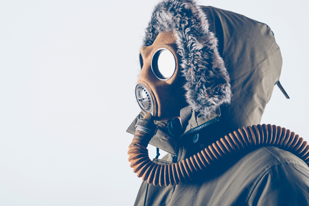 Man with old gas mask on white background