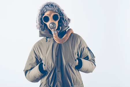 Scary man with vintage gas mask on white background photo