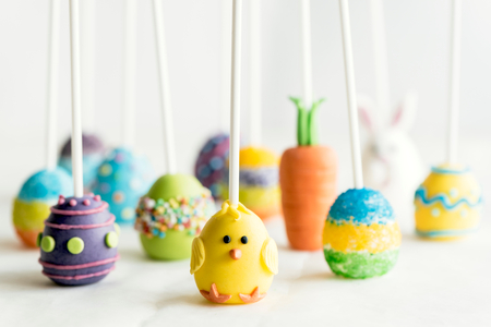 Easter cake pops on white background,selective focus