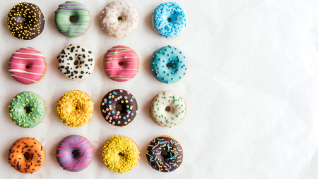 Variety of sweet homemade donuts with blank space