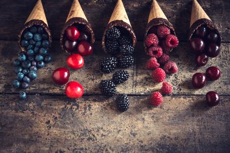 Fresh berries in the ice cream cones