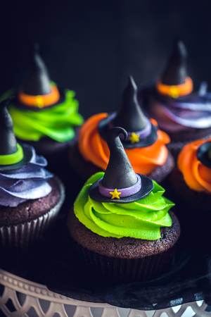 Witch hat cupcakes as halloween decoration,selective focus