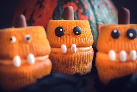Scary pumpkin cup cakes,selective focus