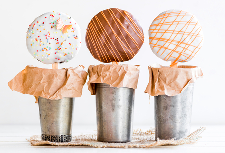 Sweet cookies on the stick in basket Stock Photo