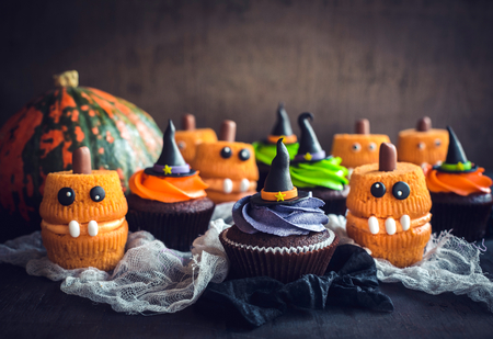 Scary Halloween cup cakes on the table,selective focus Stock Photo