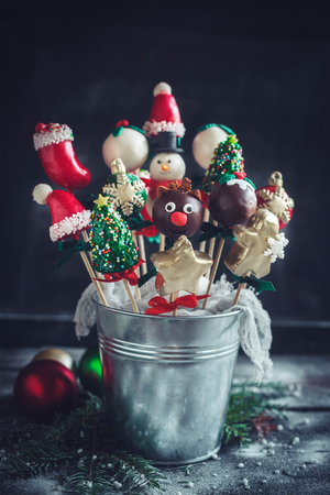 Christmas cake pops served in the metal basket Stock Photo