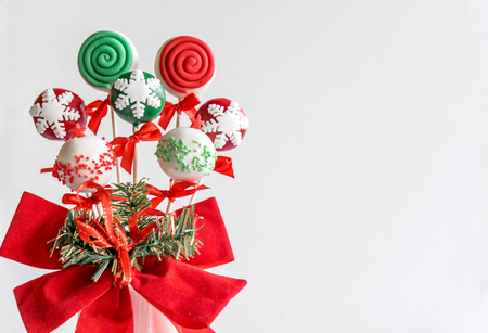 Christmas cake pops served on white background,blank space