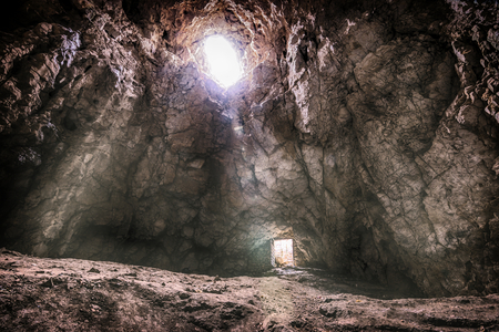 Light and opened door in the Cave