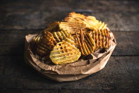 Fresh baked homemade potatoes chips,selective focus